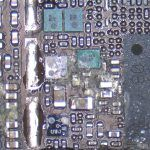 This is the GPS chip. The corrosion is caused by liquid damage to this iPhone logic board.